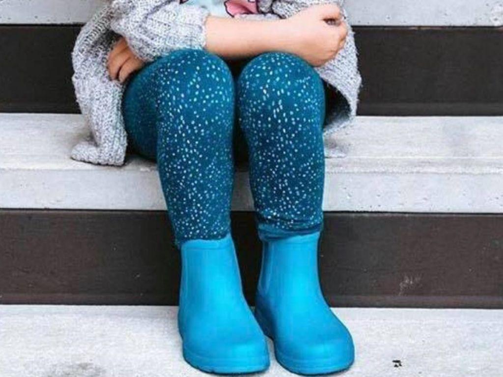 little girl wearing low rain boots