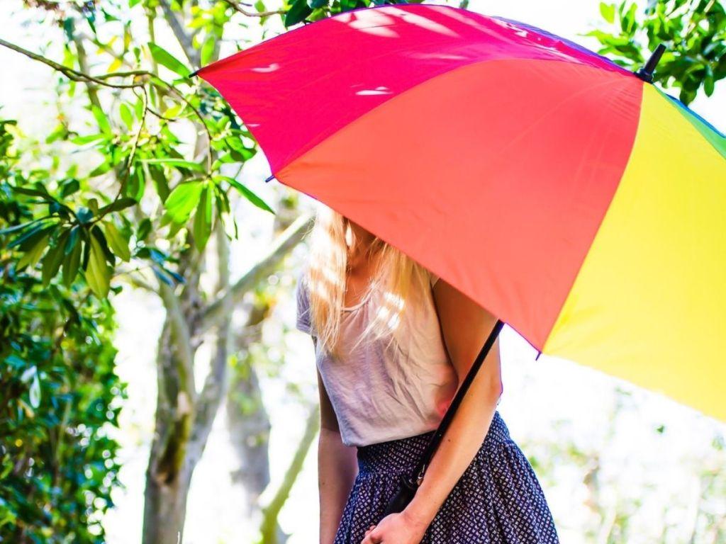 woman holding giant golf umbrella