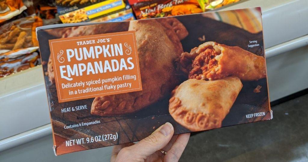 hand holding a box of Trader Joe's Pumpkin Empanadas