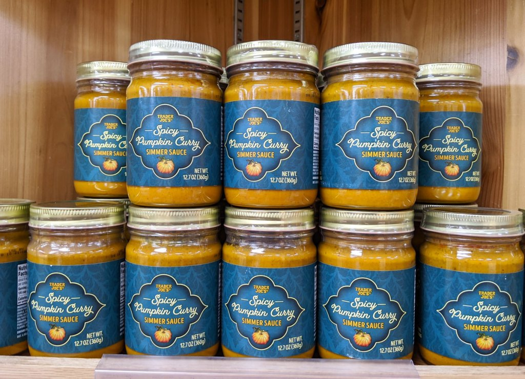 glass jars of spicy pumpkin curry sauce