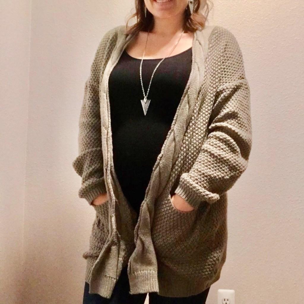 woman wearing olive cardigan sweater