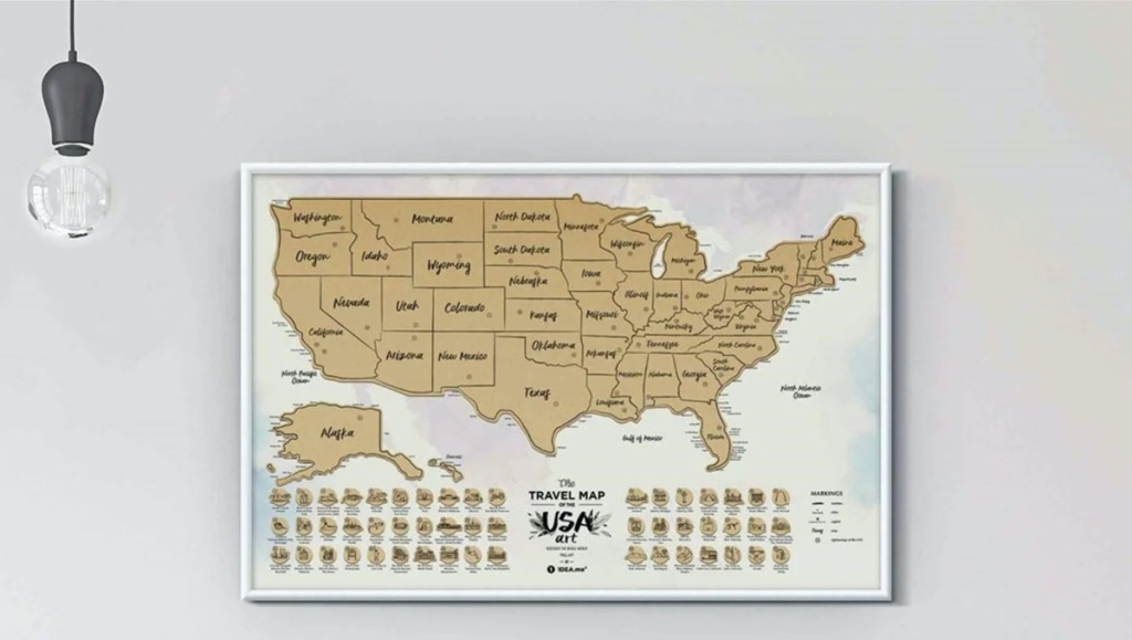 scratch off USA map on white wall with light sconce