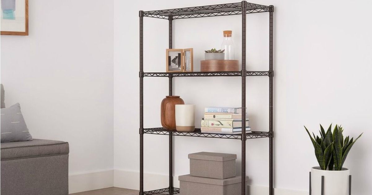set of wire shelves shown in living area with books, decor, and frames