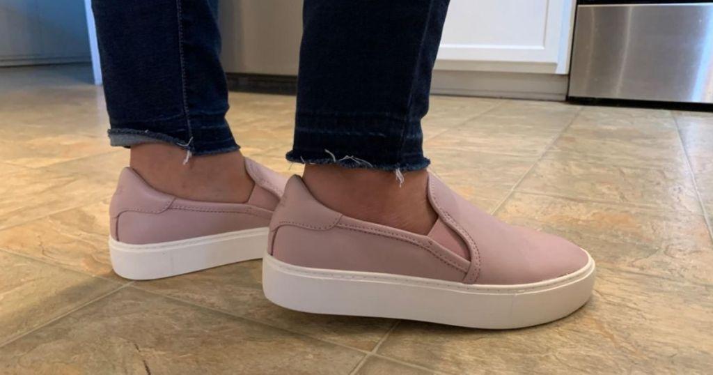 woman wearing Ugg slip on Jass sneakers