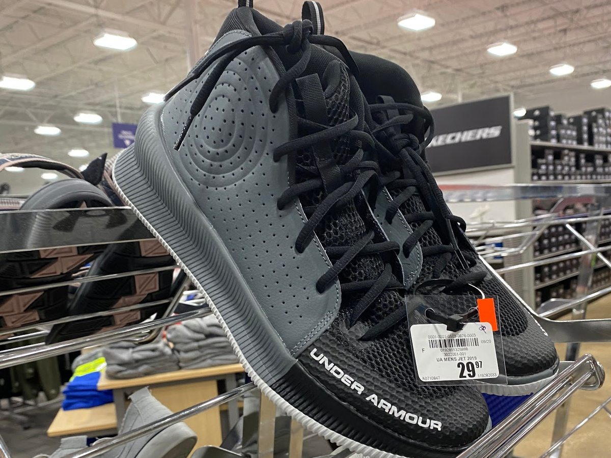 gray and black basketball shoes on shoe rack store display