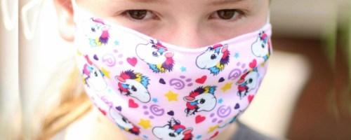 girl wearing Unicorn Face mask