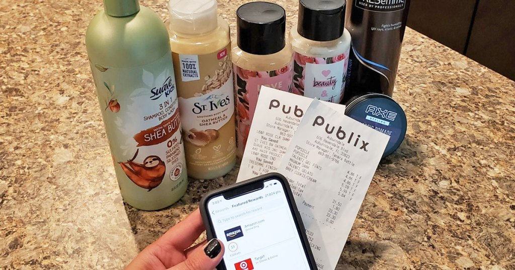 person holding smart phone and publix receipts in front of unilever brand personal care products