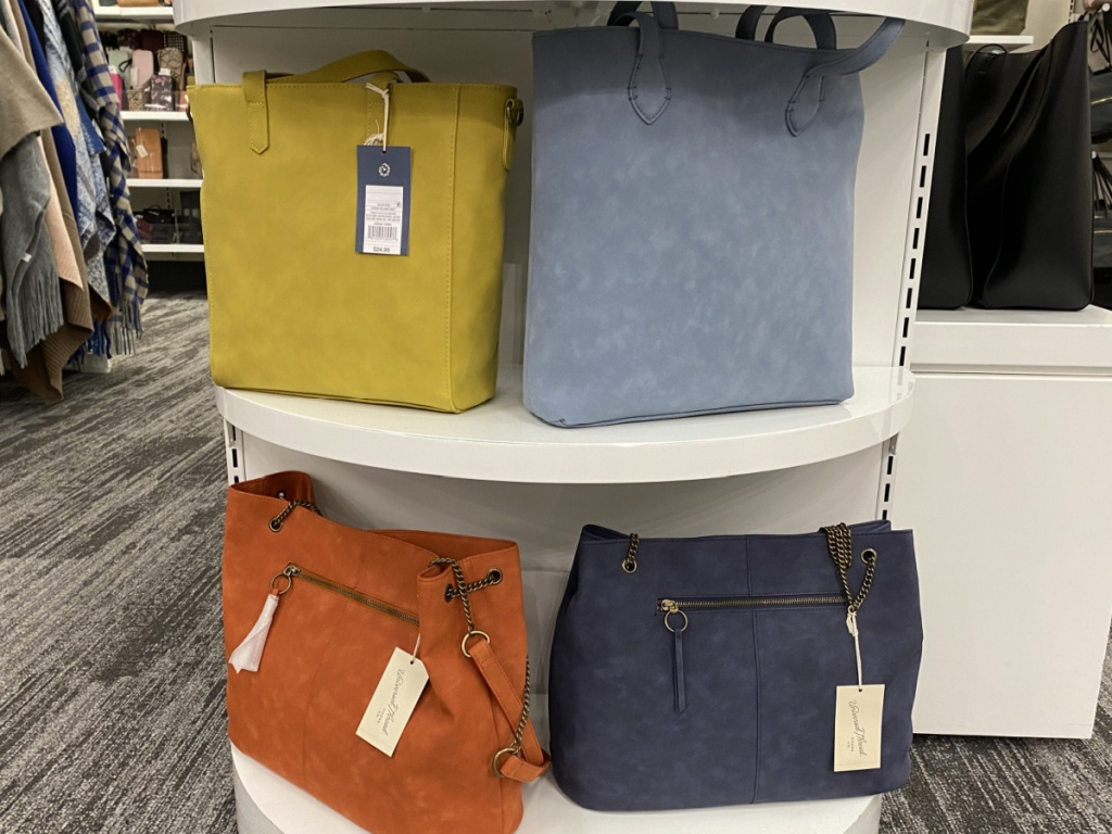 four handbags on display in store