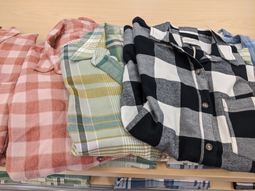 red, green, and black Universal Thread Women's Plaid Long-Sleeve Button-Down Shirt folded on display at target