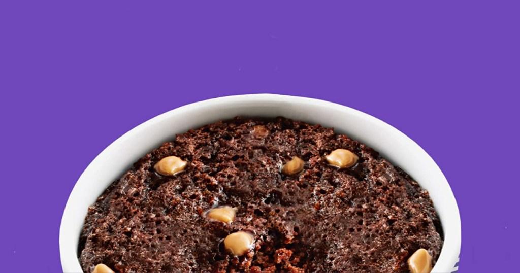 duncan hines mug cake with purple background