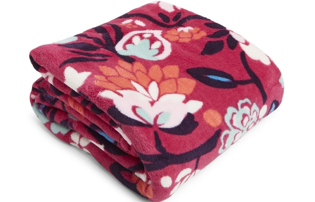 pink blanket with flowers on it