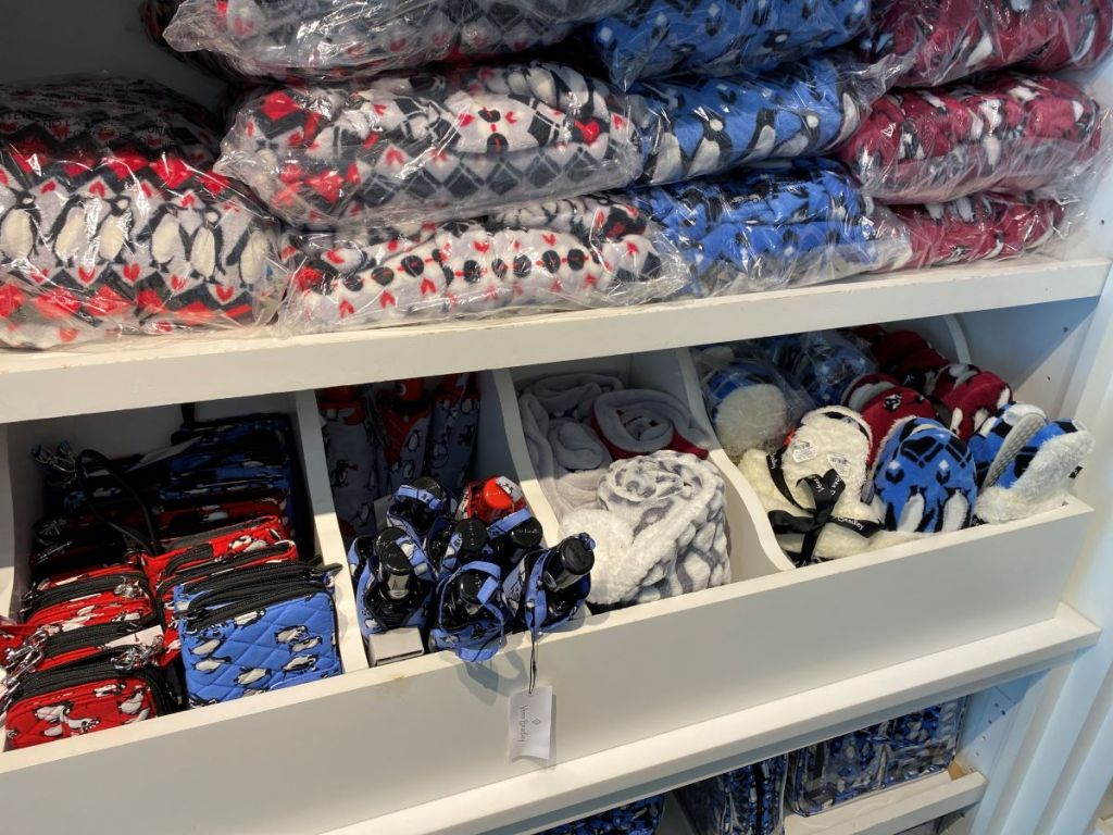 Vera Bradley blankets and accessories on shelf at the store