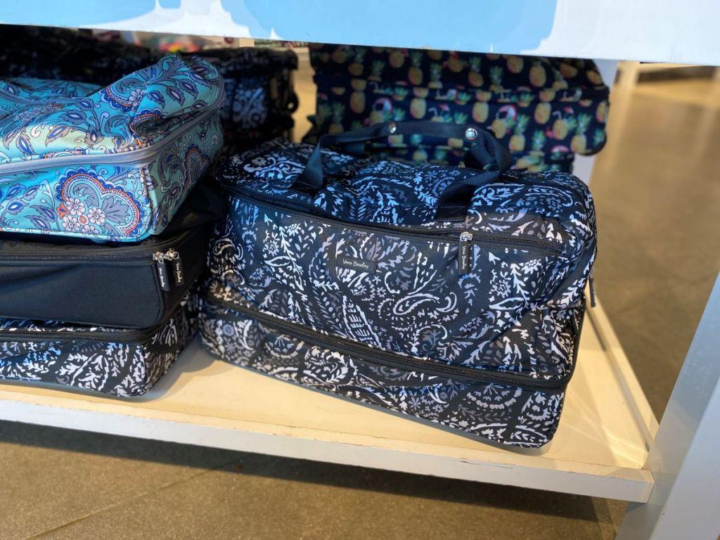 Vera Bradley suitcase on a shelf