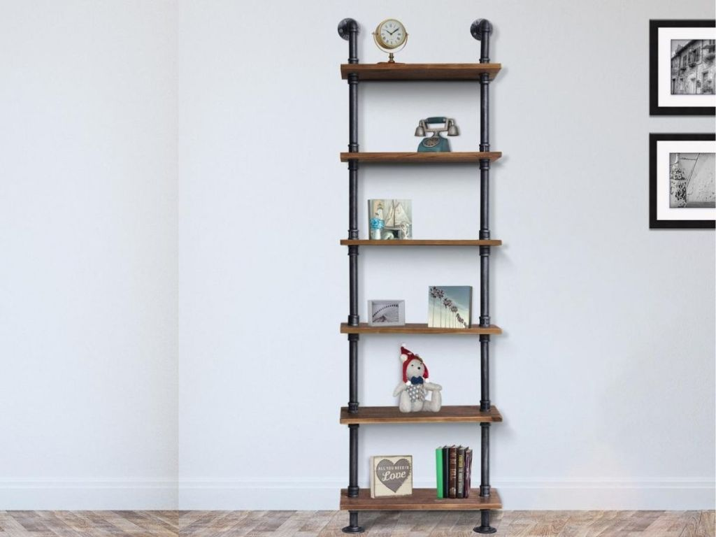pipe and wood shelf with Knick knacks on it