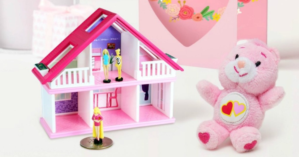 worlds smallest barbie house with a care bear next to it