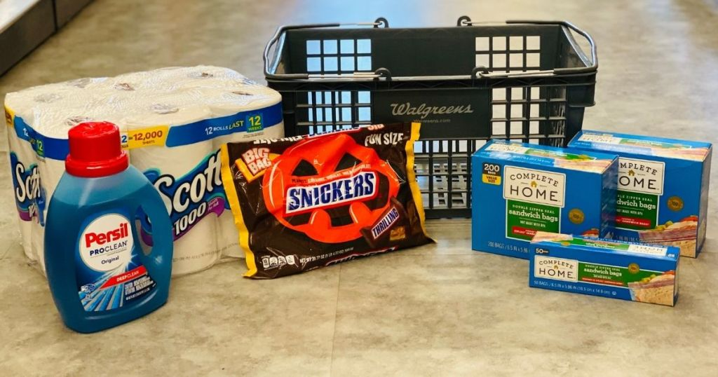 toilet paper, laundry detergent, candy and storage bags by Walgreens basket