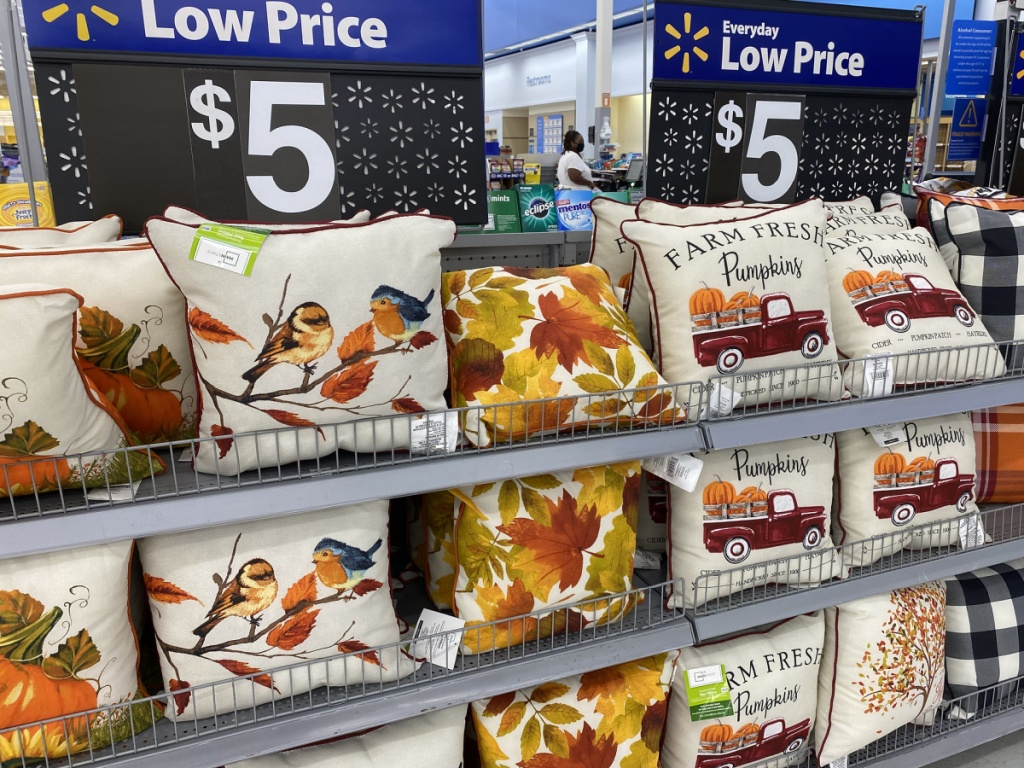 fall harvest throw pillows on display at walmart