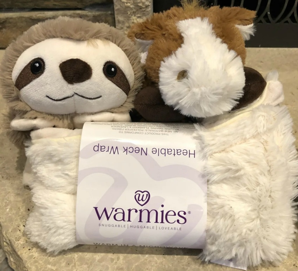 Two Warmies plush wraps on counter top - sloth and horse