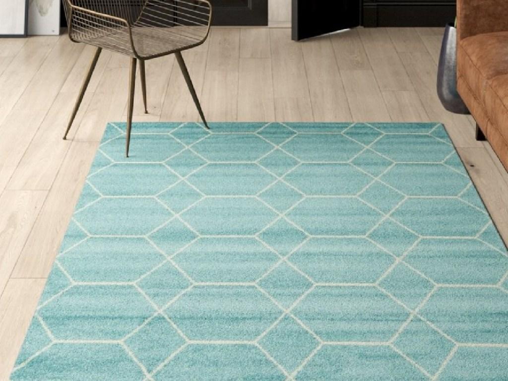 Wayfair light aqua teal area rug on a hardwood floor