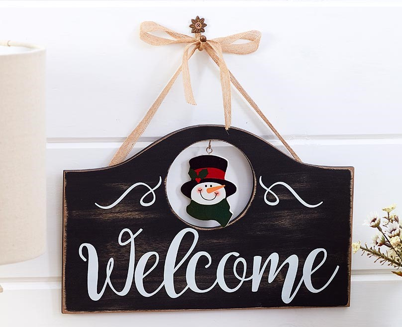 welcome sign with a snowman on it