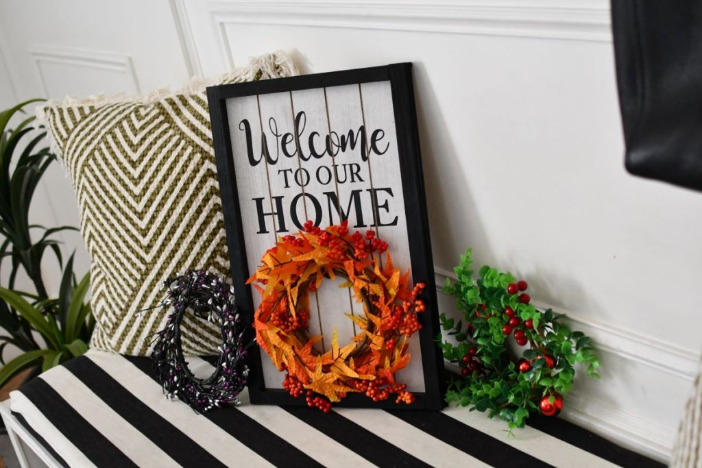Welcome To Our Home Sign with three wreaths