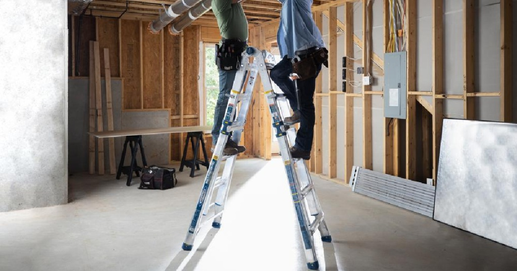 two men on ladder in construction site
