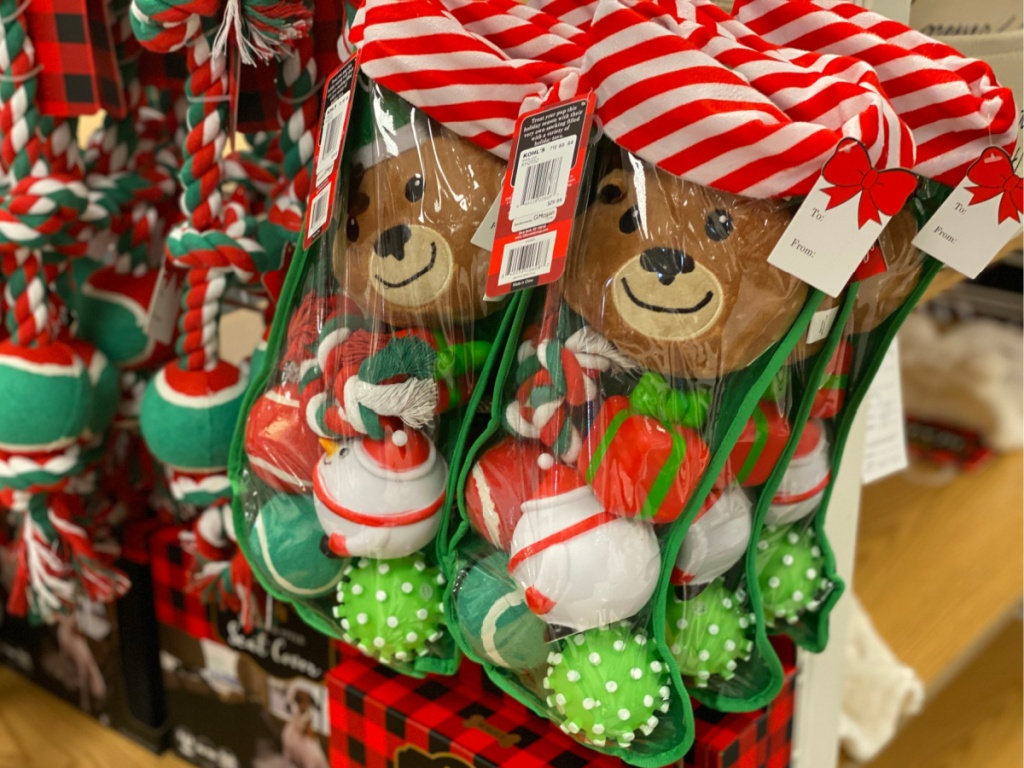 dog toys in stocking hanging in store