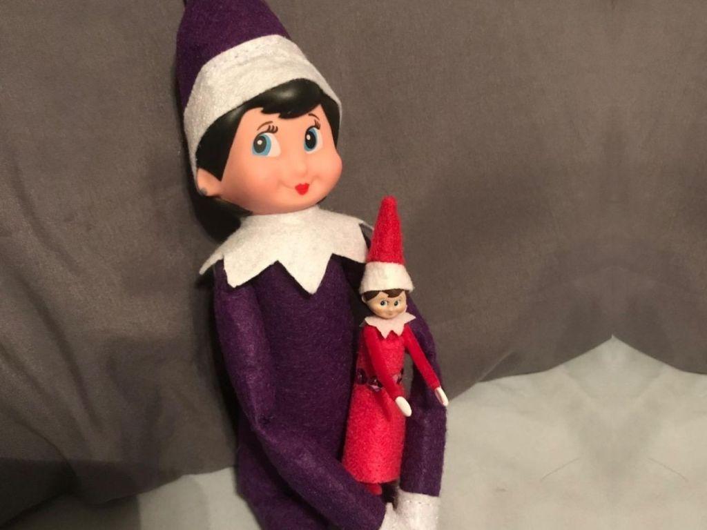 The World's Smallest Elf on the shelfheld by a regular full size elf