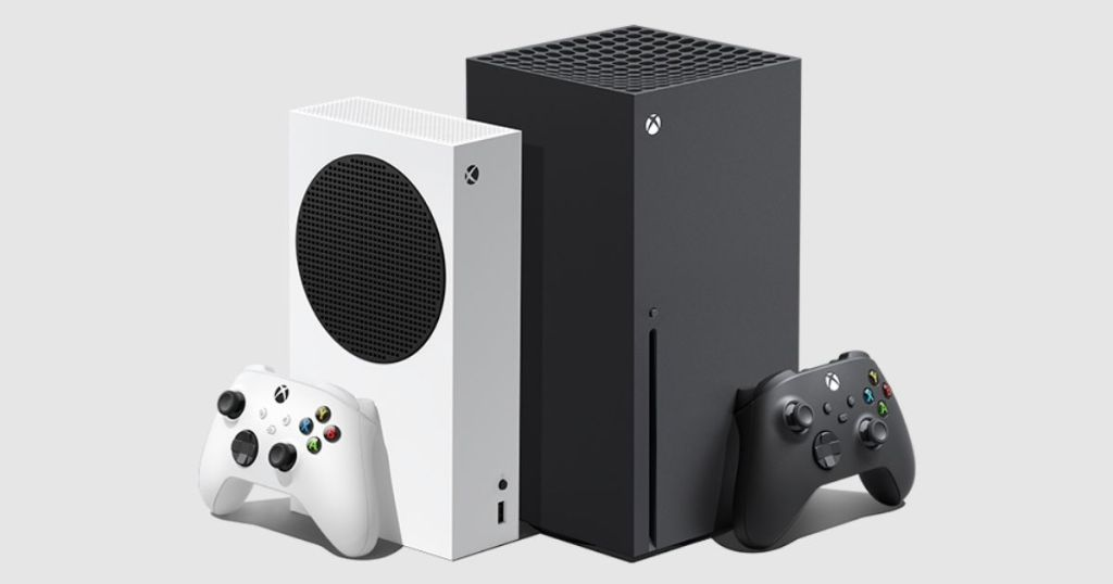 two Xbox consoles and controllers