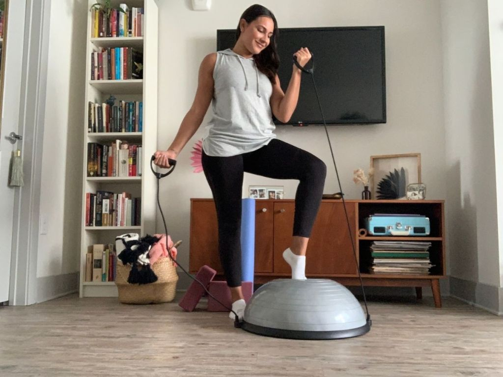 woman using balance ball to work out