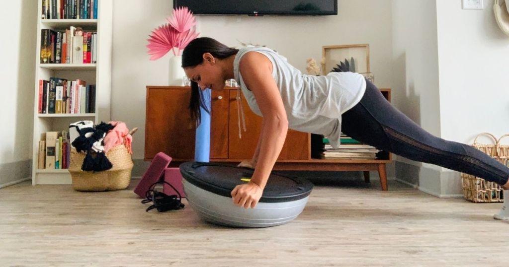 woman doing push ups on balance ball