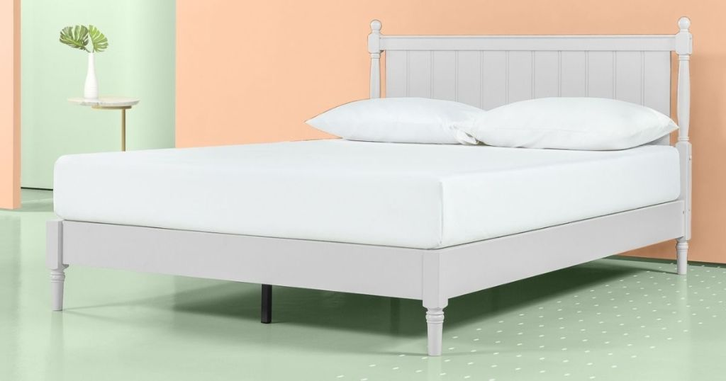 platform bed with two pillows on it