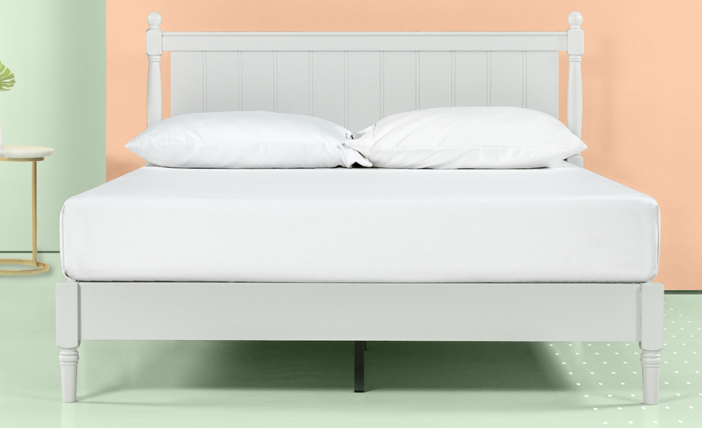 bed with pillows on it