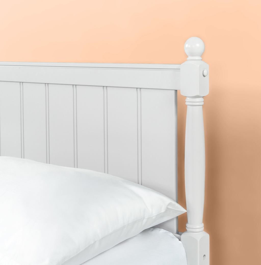 headboard on a bed with a pillow on it