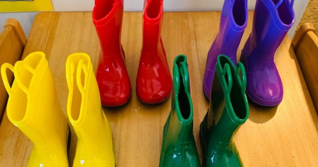 four pairs of Zoogs kids rain boots