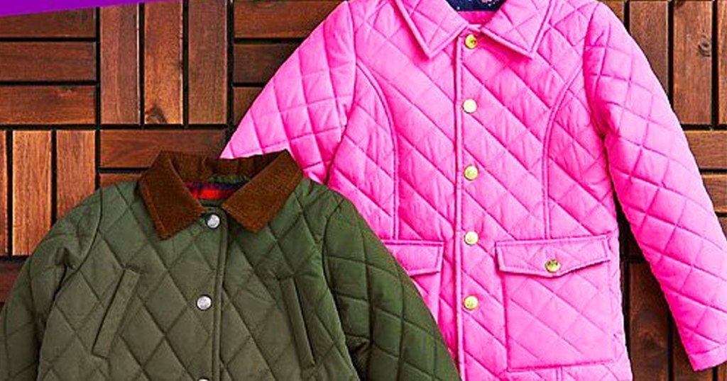 two girls quilted jackets on floor in pink and olive green colors