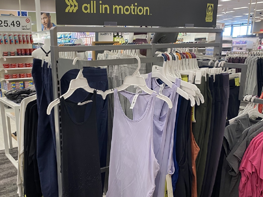store display with tank tops hanging