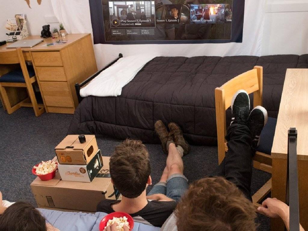 people sitting in room watching tv