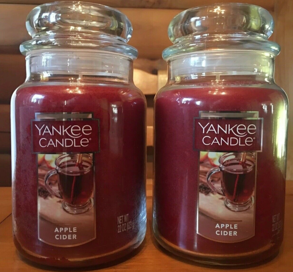 two apple cider jar candles sitting on counter
