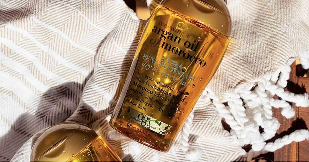 bottle of argan oil shampoo on a blanket