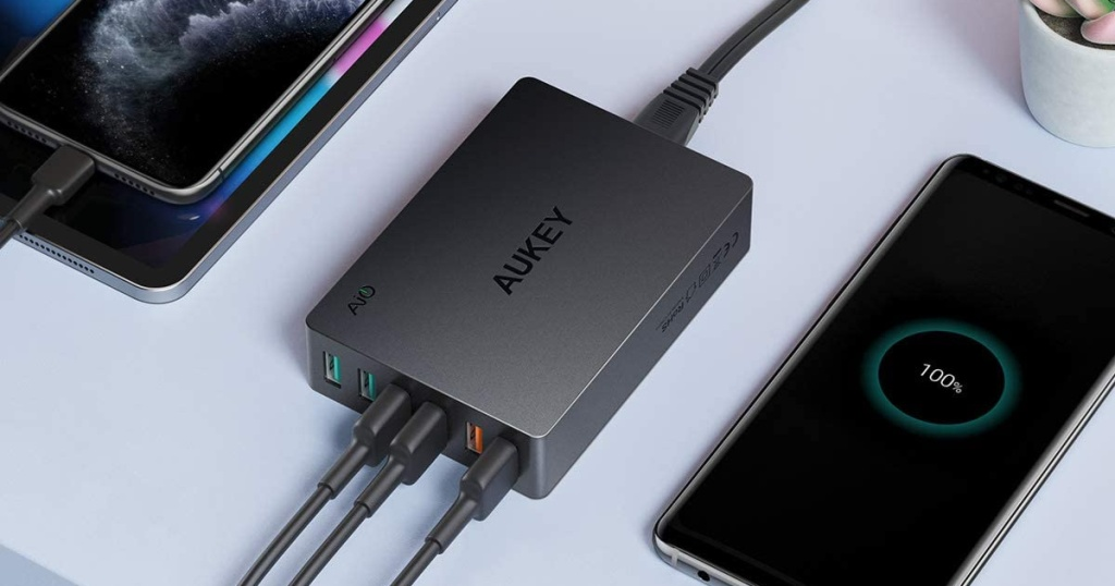 aukey charging station charging phone and tablet