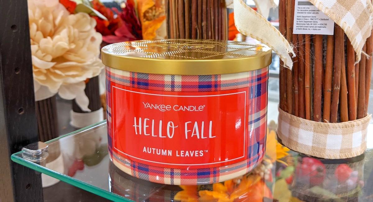 hello fall autumn leaves candle on glass shelf