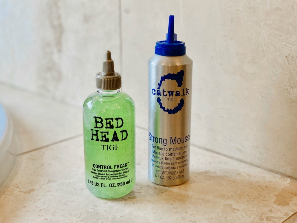 bed Head & Catwalk products next to each other by a bathtub