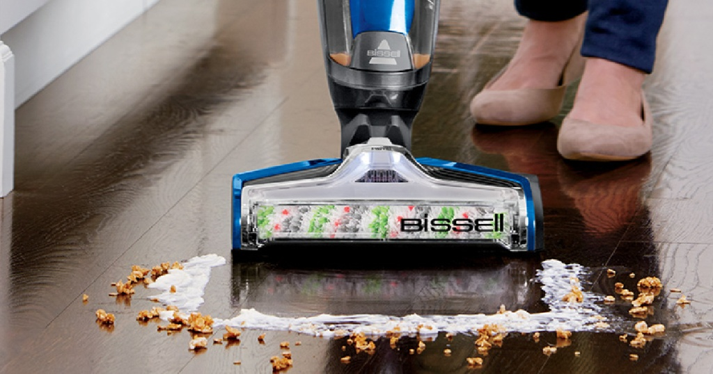 vacuum cleaner on hard floor cleaning up wet cereal