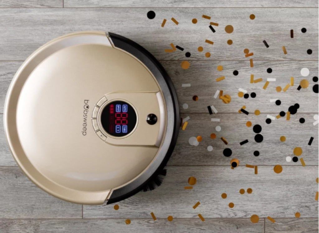 bobsweep robot vacuum running over confetti