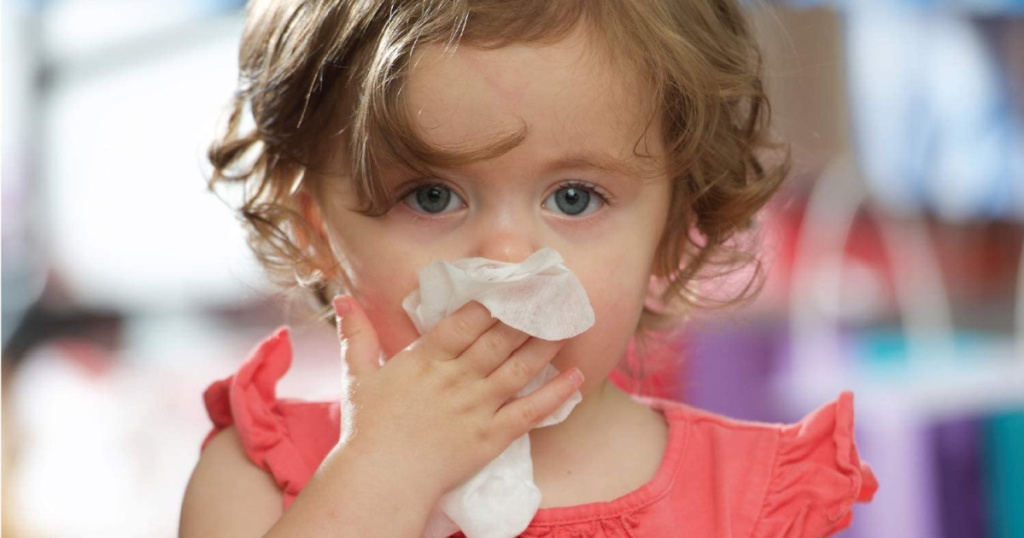 child wiping nose with boogie wipe