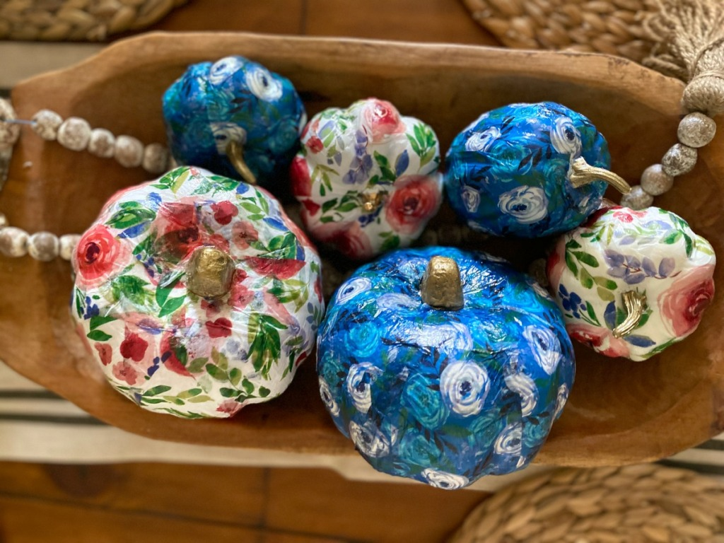 bowl with dollar tree tissue paper pumpkins on a table