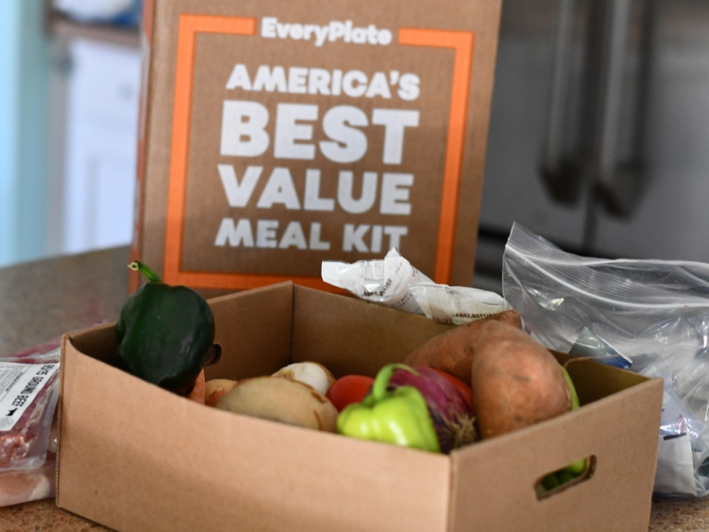 box of vegetables on kitchen counter