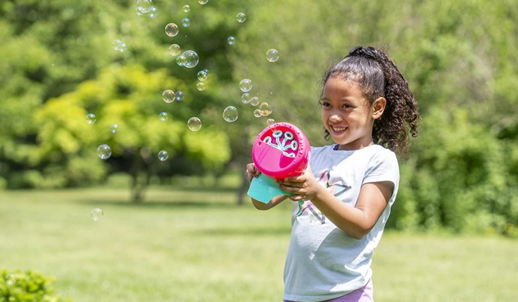 little girl holding bubble machine