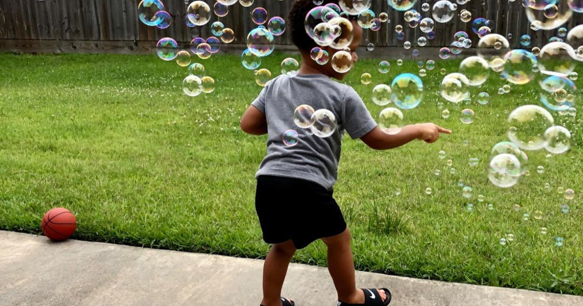 boy with tons of bubbles in the air